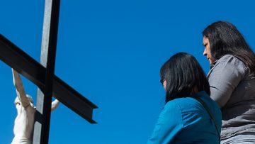 people facing Jesus on the cross