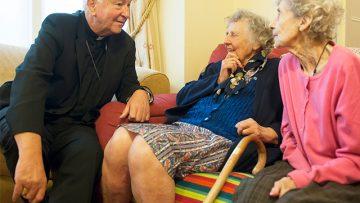 Archbishop Vincent Nichols visits 'Contact the Elderly' tea party
