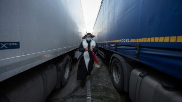 Lorry drivers receive spiritual sustenance as they wait to cross the English Channel at Christmas