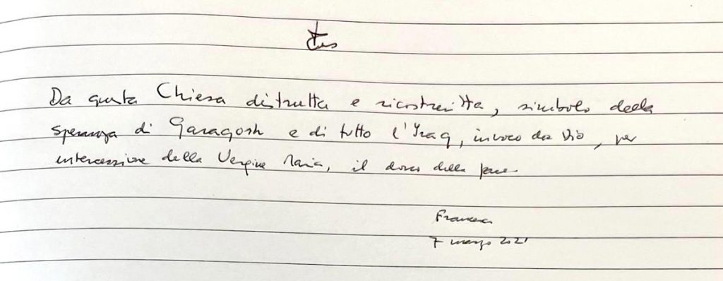 Pope Francis signs the Book of Honour in the Church of the Immaculate Conception, Qaraqosh